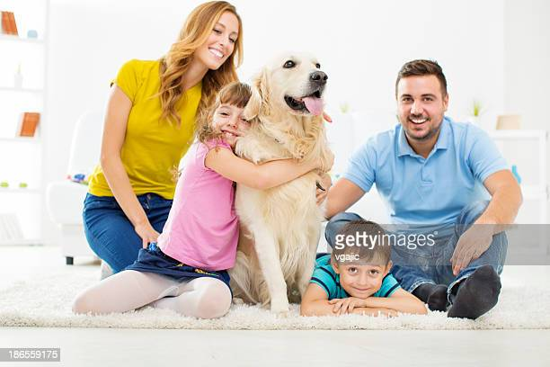 Happy Family With Dog at Home.