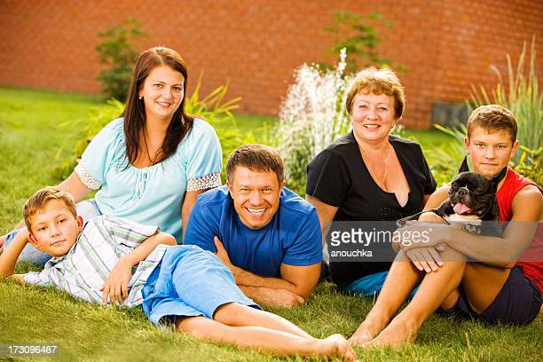 Happy Family with French Bulldog Outdoor Portrait