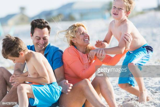 Happy family with two boys on beach