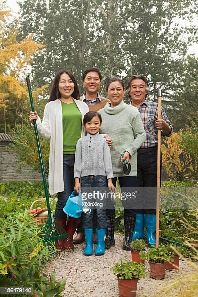 Happy family working in garden