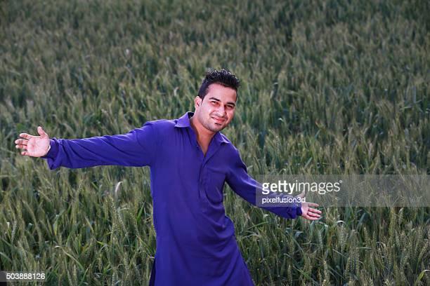 Happy farmer in his wheat field