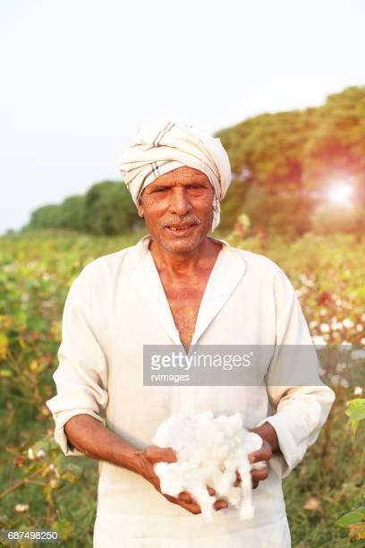 Happy farmer with cotton