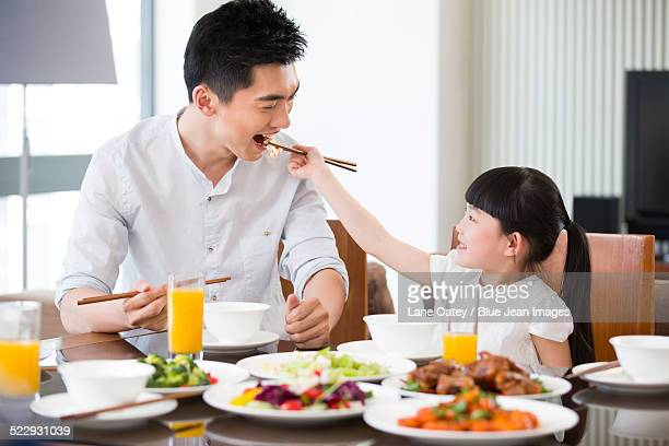 Happy father and daughter having lunch