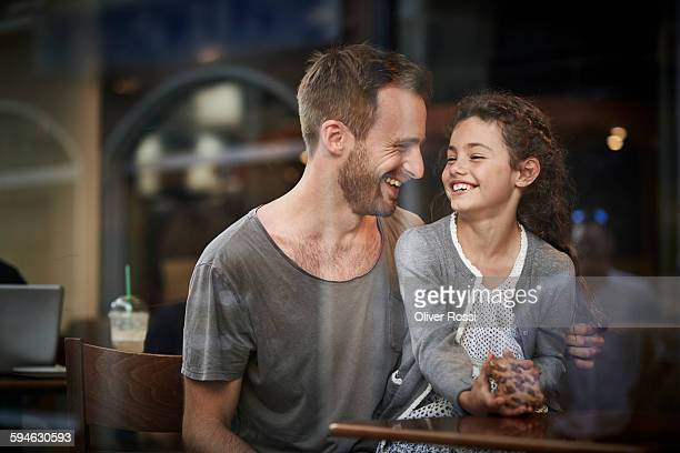 Happy father and daughter in a restaurant