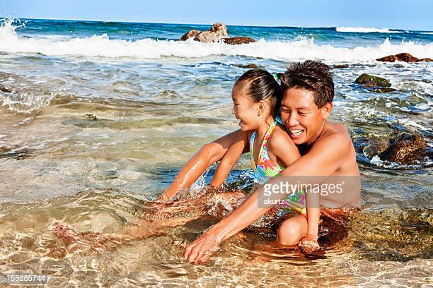 Happy Father and Daughter playing at the Beach