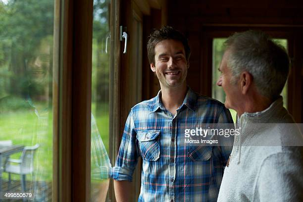 Happy father and son in cottage