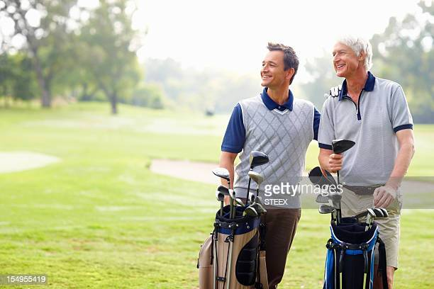 Happy father and son on a golf course