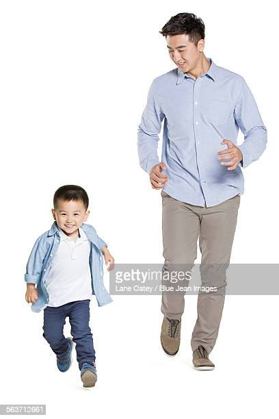 Happy father and son running