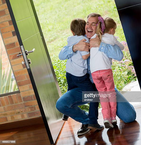 Happy father greeting his children
