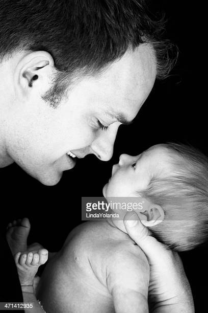 Happy Father Holding Newborn