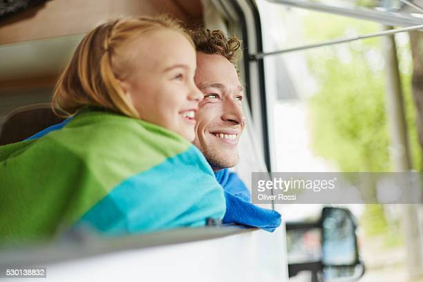 Happy father with daughter in a caravan