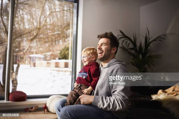 Happy father with son at home