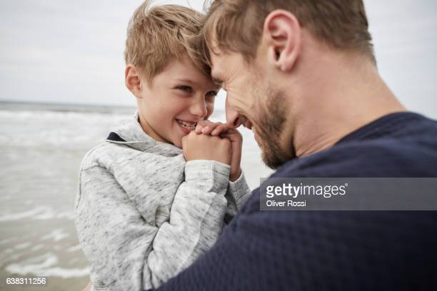 Happy father with son on the beach