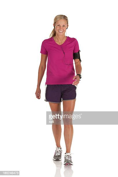 Happy female athlete walking