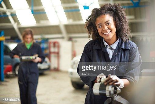 happy female auto mechanic