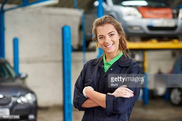 happy female auto mechanic trainee