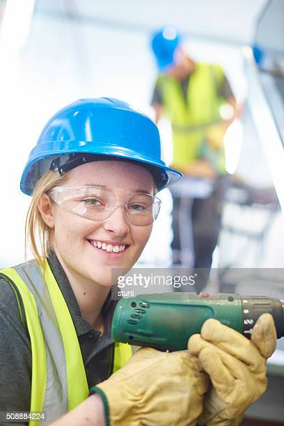 happy female construction worker at work