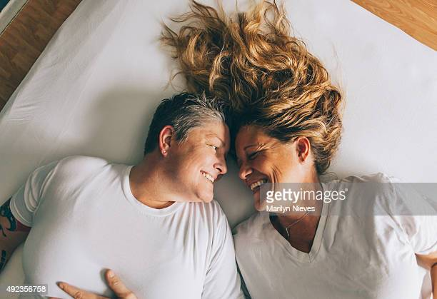happy female couple laughing