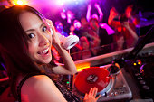 Female DJ in a nightclub in Tokyo, Japan.