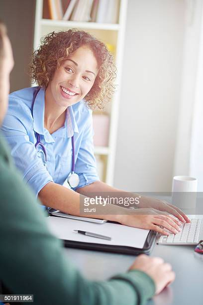 happy female doctor with patient