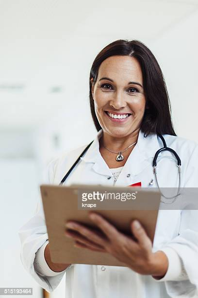 Happy female doctor working in hospital