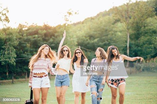 Happy female friends having fun outside in nature : Stock Photo