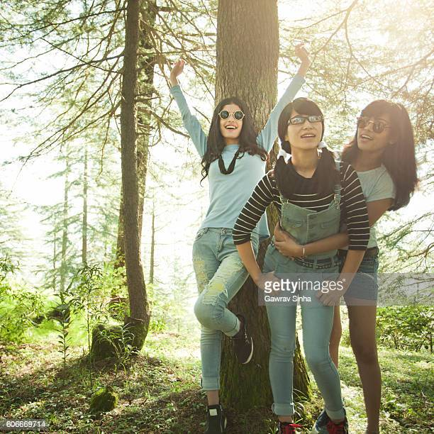 Happy female friends of different ethnicity doing fun in nature.