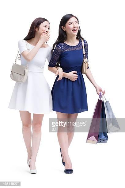 Happy female friends shopping