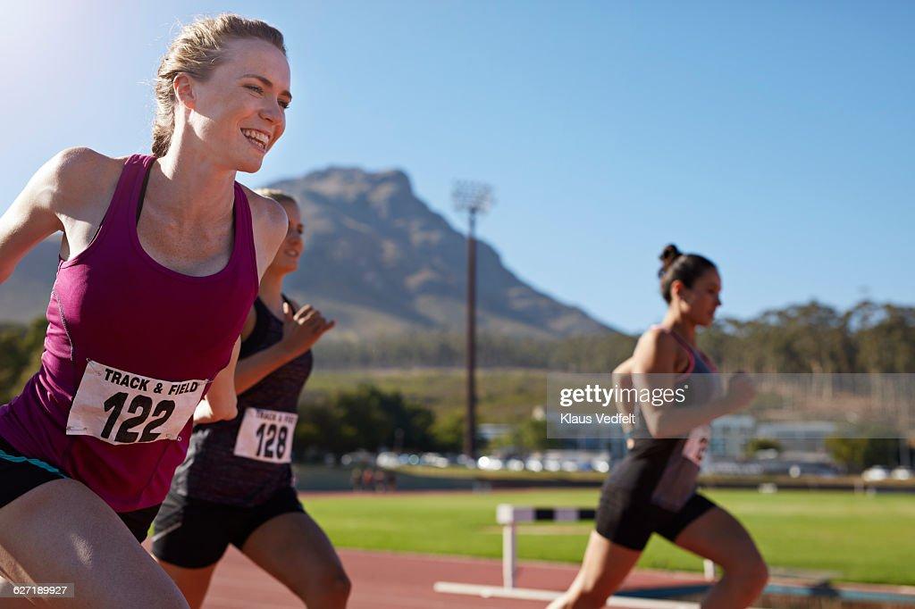 Happy female runner crossing the finish line : Stock Photo