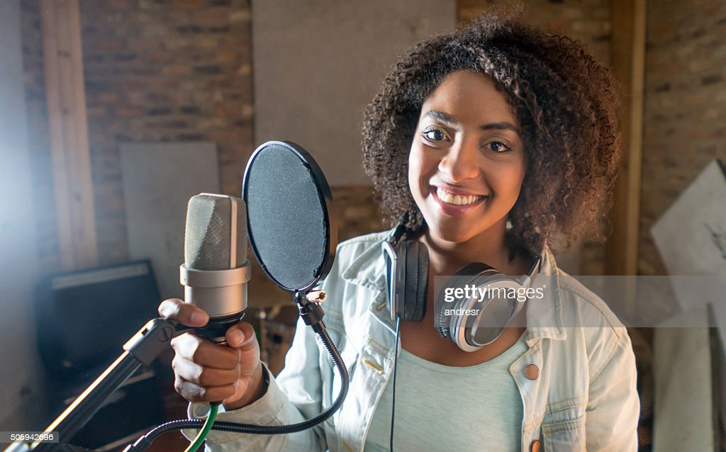 Happy female singer at a recording studio