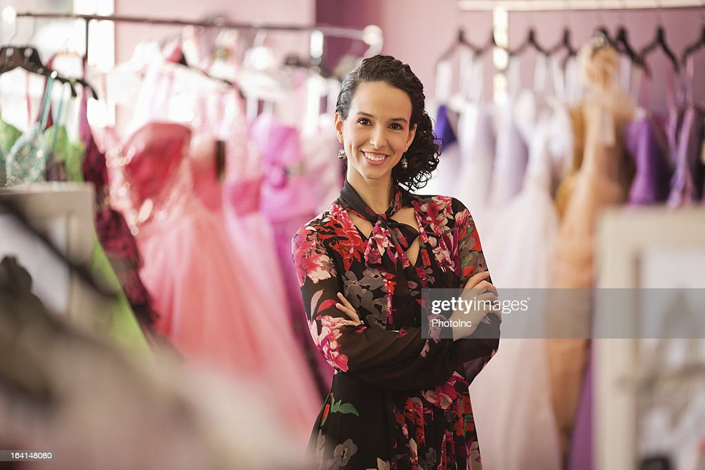 Happy Female Store Owner Standing With Arms Crossed