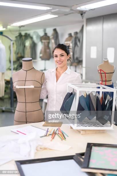 Happy female student at a fashion design school