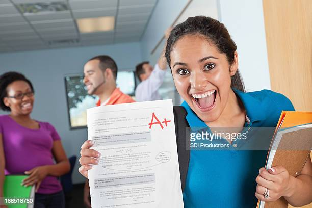 Happy Female Student in Class With Great Test Grade