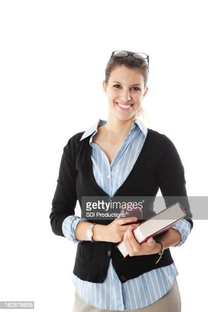 Glücklich weibliche Lehrer hält Apple und Buch