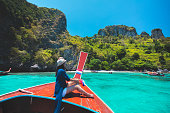 Happy female traveling on boat, Krabi Thailand