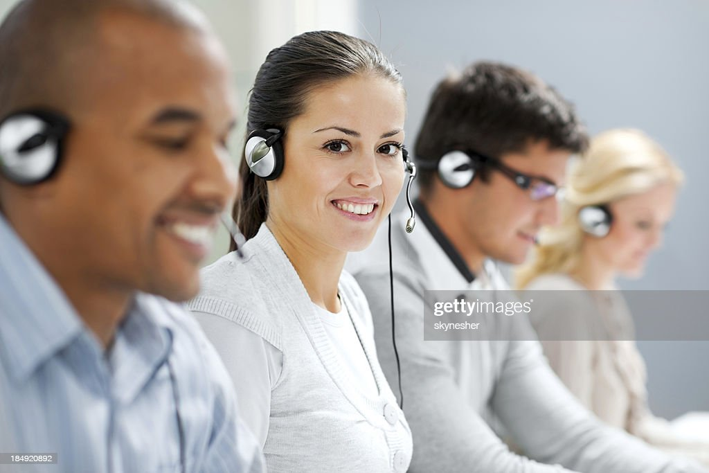 Happy female wearing headset and looking at camera.