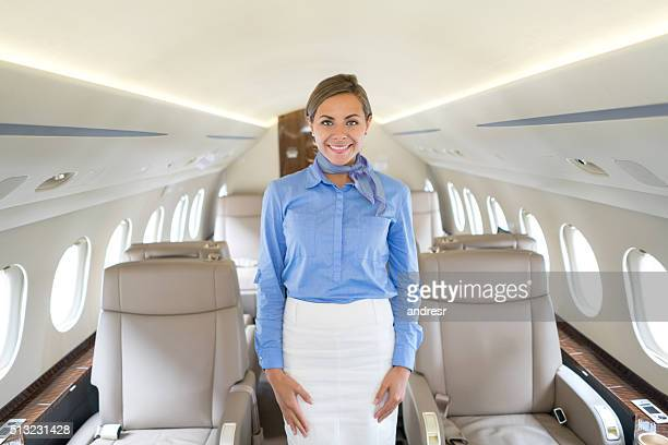 Happy flight attendant in an airplane