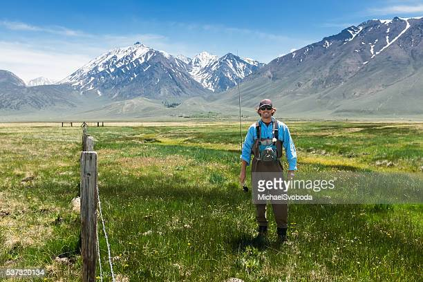 Happy Fly Fisherman Smiling In A Mountain Meadow