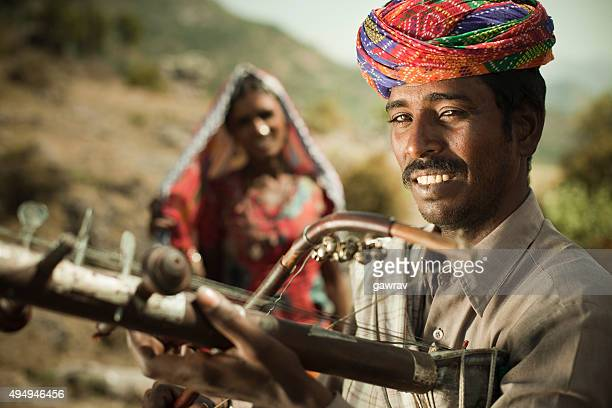 Happy folk musician of Rajasthan, India playing Ravanahatha in hills.