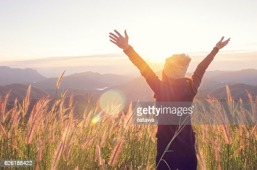 Happy Freedom in sunrise nature : Stock Photo