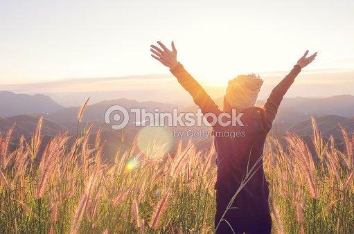Happy Freedom in sunrise nature : Stock Photo
