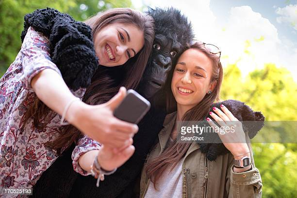 Happy friends and a Gorilla Taking Photo with Mobile Phone