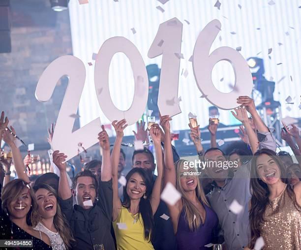 Happy friends celebrating New Years 2016