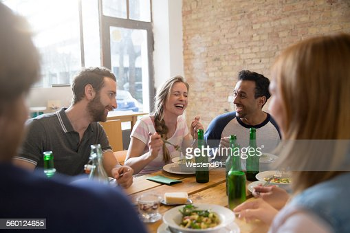 Happy friends eating together