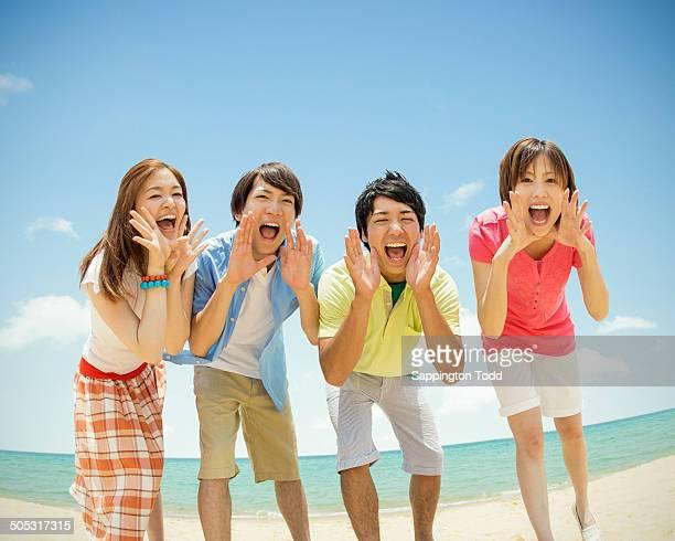 Happy Friends Enjoying At Beach