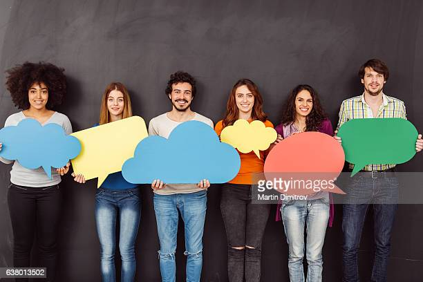 Happy friends holding speech bubbles