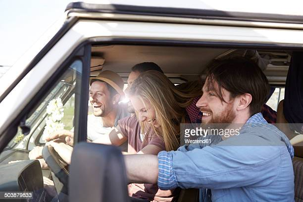Happy friends in minivan