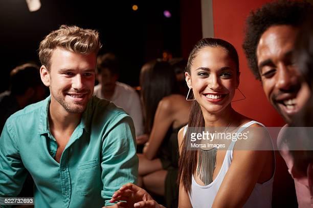 Happy friends in nightclub