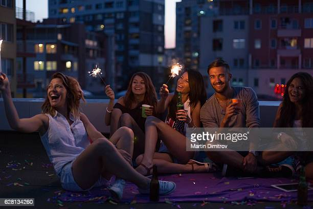 Happy friends on a rooftop party