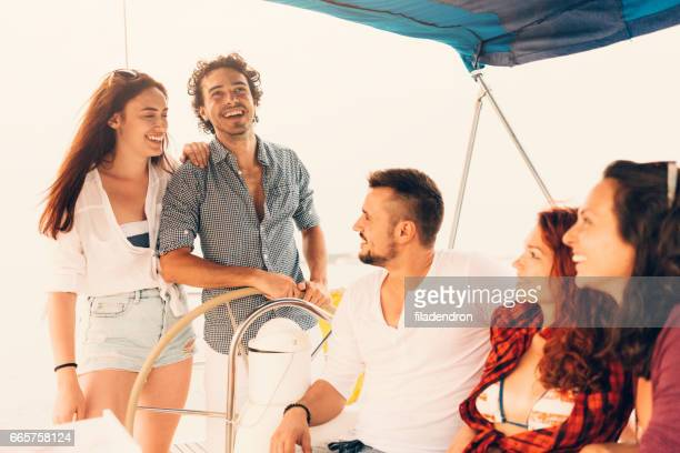 Happy friends on a yacht